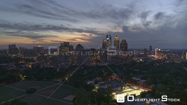 Atlanta Ascending panning view of beautifully lit midtown and Piedmont Park cityscapes at dusk