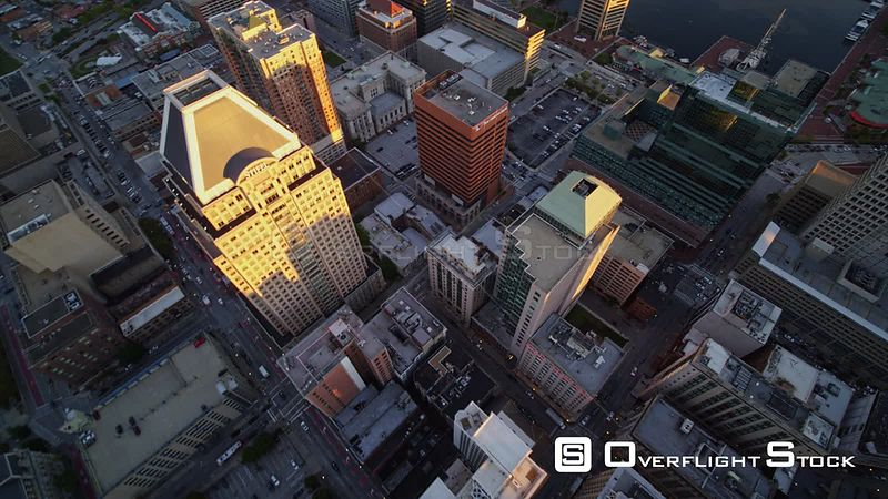 Baltimore Maryland Aerial Panning birdseye of downtown cityscape at sunset
