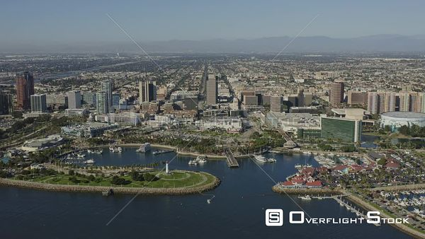 Long Beach CA Descending on marina with downtown cityscape views