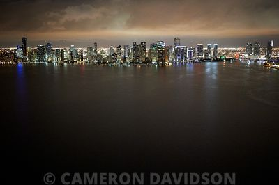 Aerial of Miami, Floirda skyline with ocean at night