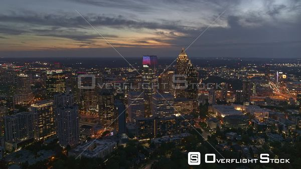 Atlanta Panning around glowing midtown cityscape at dusk with traffic