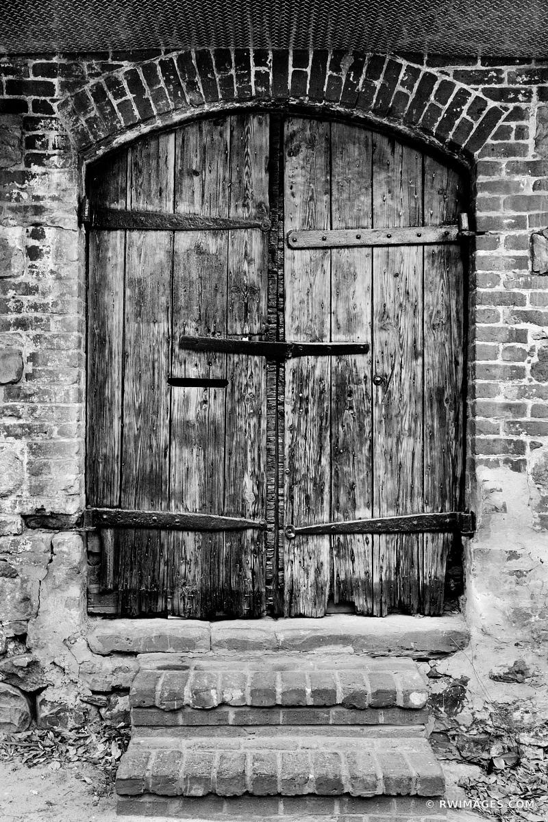 OLD WOODEN DOOR HISTORIC SAVANNAH GEORGIA BLACK AND WHITE VERTICAL