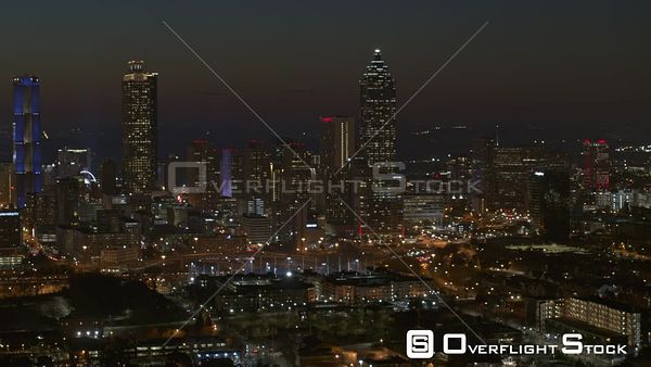 Atlanta Downtown cityscape at night panning from north to south looking west