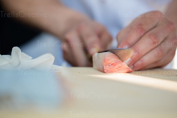 Chef preparing yellowtailed tuna sashimi.