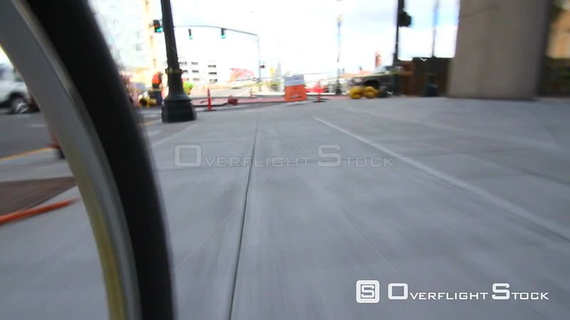 Low angle time lapse of riding a bicycle in the city and park areas. Camera attached to bike.
