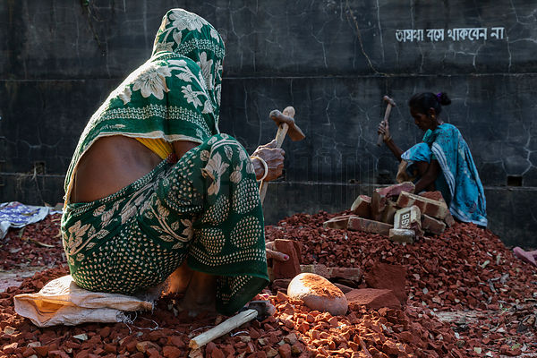 Female Day Labourers Break Bricks by Hand