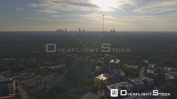 Atlanta Panning birdseye view over CDC, Emory University with downtown skylines and sunlight