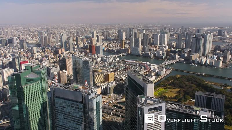 Japan Tokyo Aerial Flying low over shipyard area panning with cityscape views