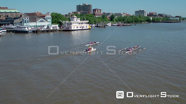 Two crew teams exercising in front of the Old Town Alexandria docks