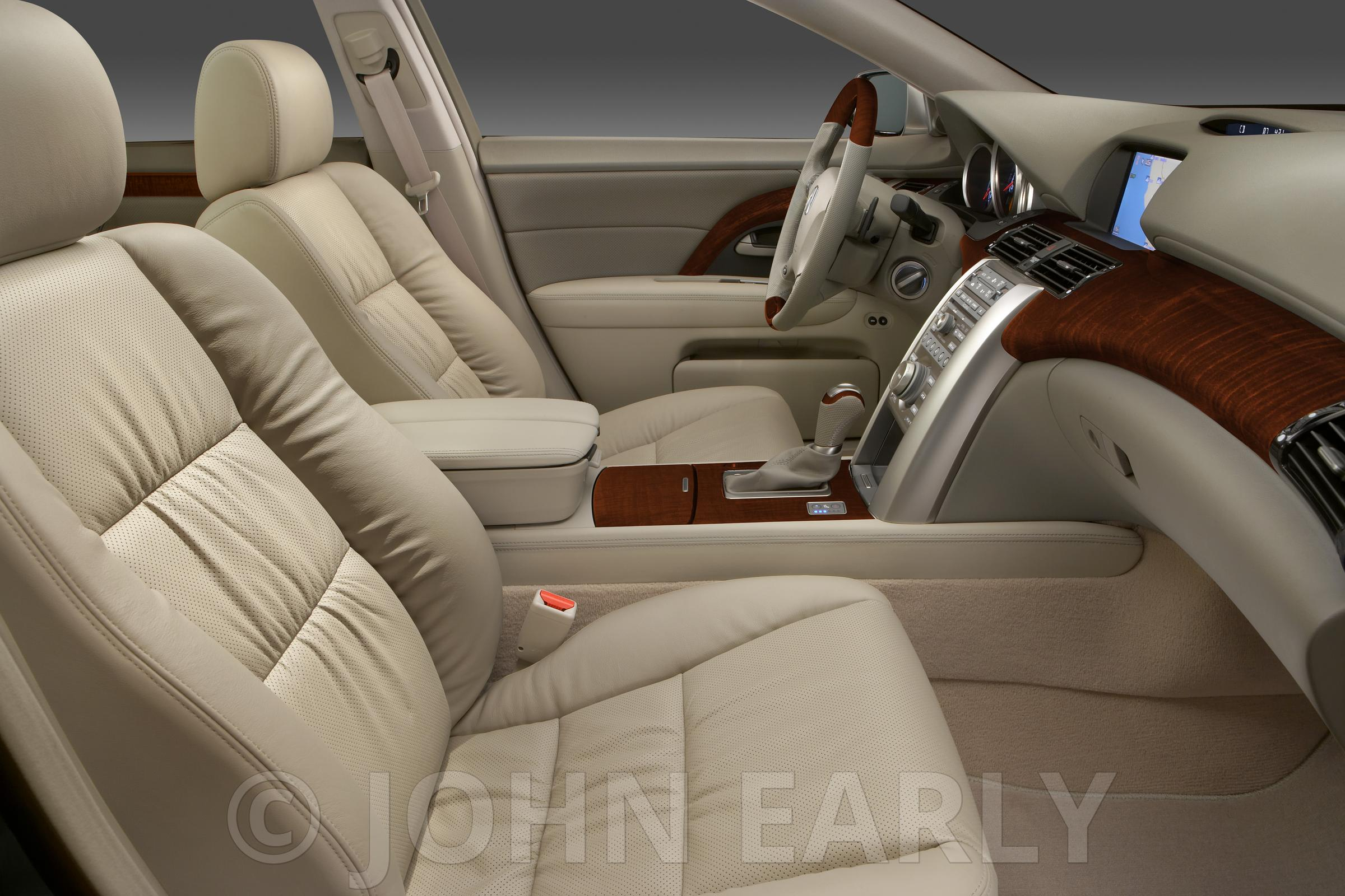Tan Interior of a Luxury Vehicle From Passanger Side