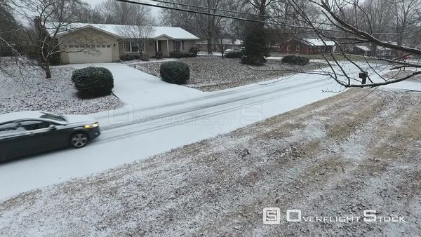 Tracking Car While Snowing in Suburban Neighbourhood Louisville Kentucky