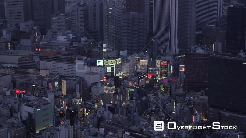 Japan Tokyo Aerial Flying low around clock tower with cityscape views at night