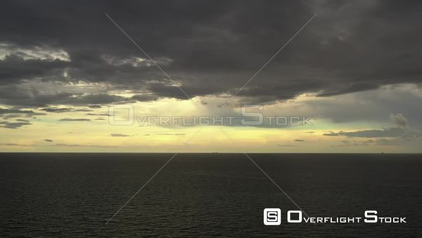 Lateral aerial storm clouds over ocean 4k 60p video