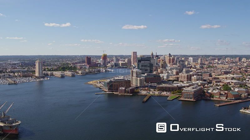 Baltimore Maryland Aerial Flying backward panning around looking at inner harbor cityscape