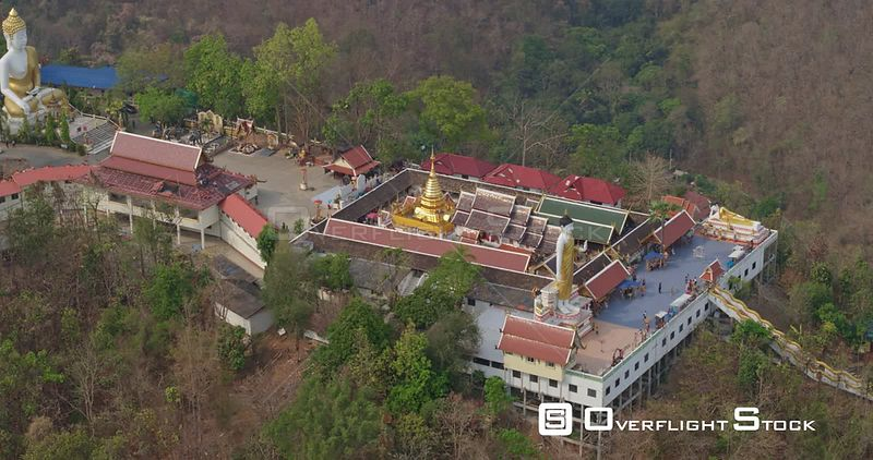 Chang Mai Thailand Aerial Flying around front view of temple with people