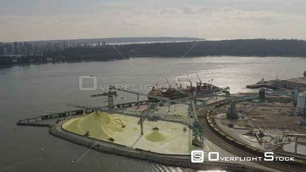 Vancouver BC Canada Panning around active industrial shipping terminal with commodity pile