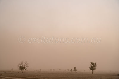Dust over farmland.