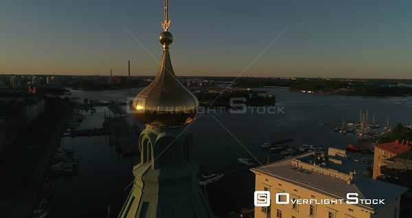 Scandinavian City, C4K aerial view around Uspetski cathedral golden cupole, revealing the city and helsingin tuomiokirkko, on...
