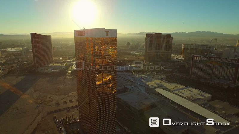 Low flying aerial backwards away from Trump hotel with cityscape strip view. Las Vegas Nevada
