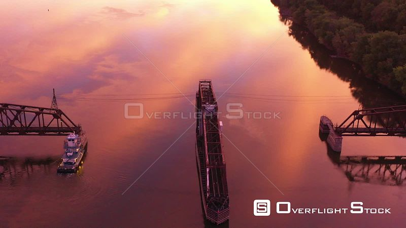 Sunrise Reflections Around a Railroad Swing Bridge, Mississippi River, Dubuque, Iowa, USA