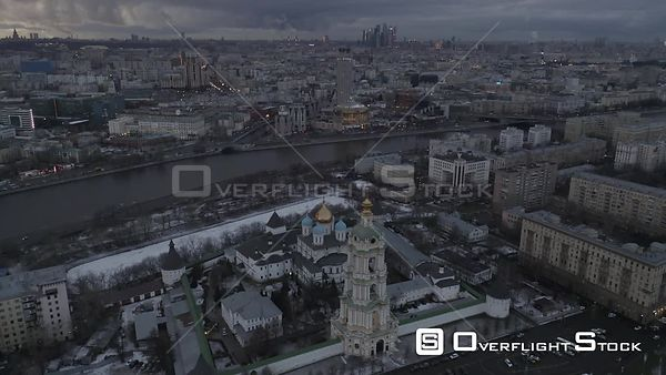 Winter Gloomy Sunset Flight Over Novospasskyi Monastery With Moscow Cityscape on a Background. Moscow Russia Drone Video View