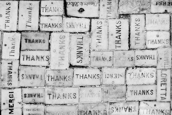 THANKS THANK YOU BRICKS AT SAINT ROCH'S CHAPEL NEW ORLEANS LOUISIANA BLACK AND WHITE