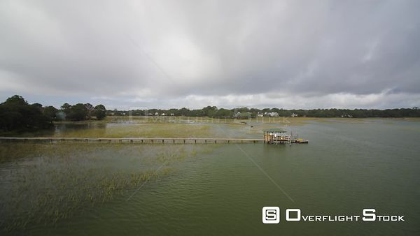 South Carolina Charleston Westchester Aerial Flying low over neighborhood waterway with moving boat