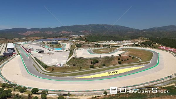 Aerial close tracking Algarve International Circuit, on a sunny day, in Portimão, Portugal