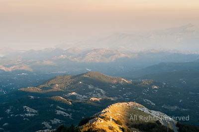 The Last Sunbeams Touching the Hills of Lovcen National Park in Montenegro, Aerial Overview