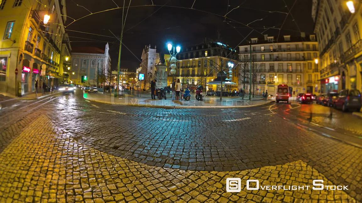 City traffic time lapse in old part of Lisbon at night. Portugal
