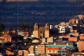 View across city to Santiago district and Belen church, Cusco, Peru