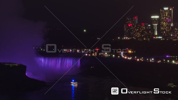Niagara Falls Ontario Short, slow panning detail of Horshoe Falls at night, purple