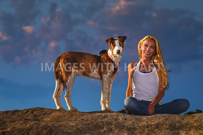 Woman.Dog.Sunset.Facing.Camera