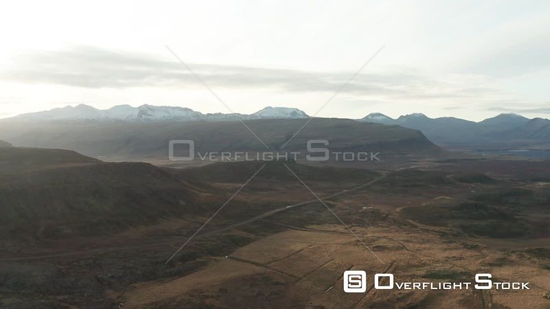 A Car Driving Towards Distant Mountains in Iceland.