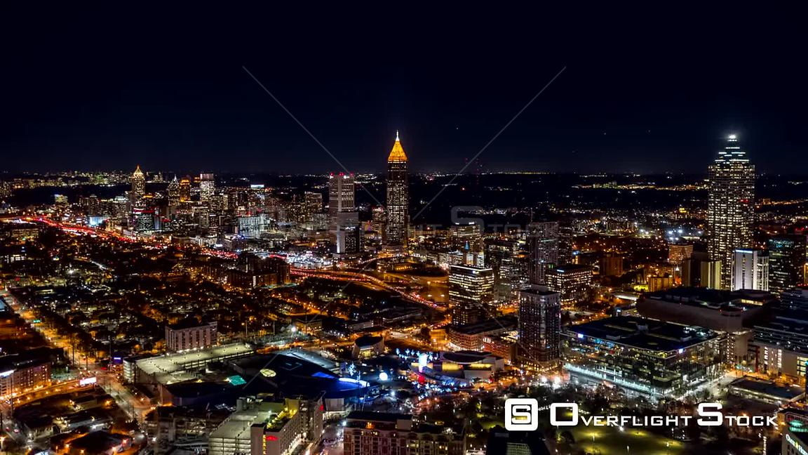 Atlanta Aerial Hyperlapse crossing low to high over downtown at night, picturesque cityscape