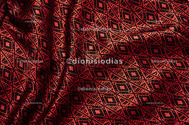 Background texture of red fabric with black print.