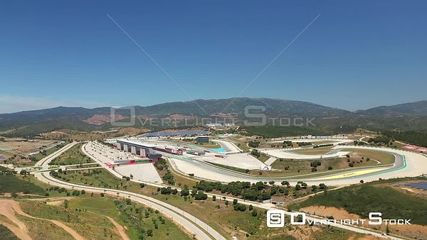 Aerial forward drone shot to Algarve International Circuit on a sunny day, in Portimão, Portugal