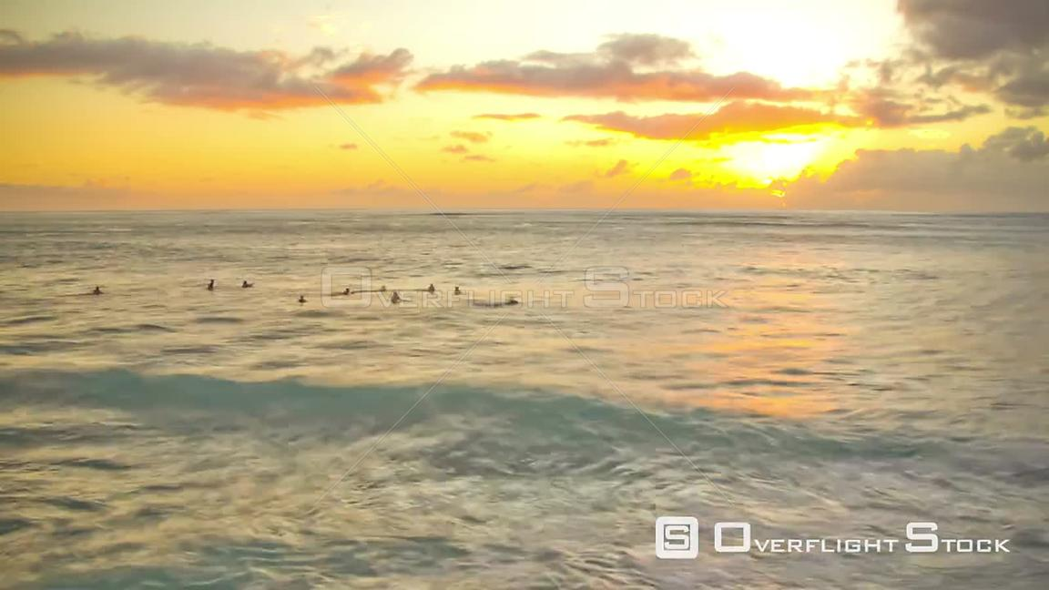 Beautiful time lapse clip of waves and surfers during sunset. Hawaii
