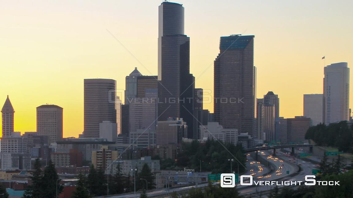 Seattle Washington State USA Seattle cityscape zooming time lapse at sunset with I5 traffic.