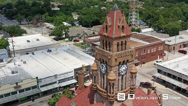 Clock tower structure and downtown businesses, Decatur, Texas, USA