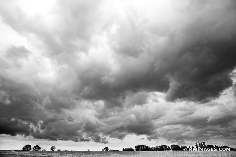 HEARTLAND STORMY SKIES OVER FARM FIELD IN SPRING CENTRAL ILLINOIS BLACK AND WHITE