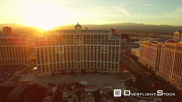 Side view low flying aerial over strip Las Vegas Nevada