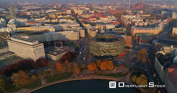 Helsinki city, C4K aerial, tilt drone shot, of the ympyratalo, in the Hakaniemi cityscape, near merihaka and kallio, on a sun...