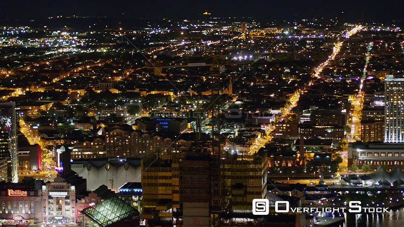 Baltimore Maryland Aerial Panoramic nighttime cityscape view with highrise construction in forefront