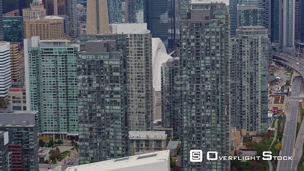 Toronto Ontario Birdseye fly through Entertainment District cityscape with expressway