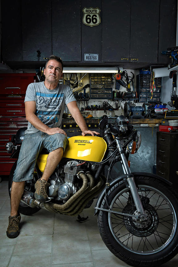 Location portrait of Daniel Honda motorcycle mechanic, Montreal editorial photographer