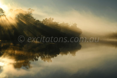 Sunlight through fog, Murray River near Mildura, Australia