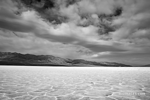 SALT FLATS BADWATER BASIN DEATH VALLEY CALIFORNIA BLACK AND WHITE AMERICAN SOUTHWEST DESERT LANDSCAPE