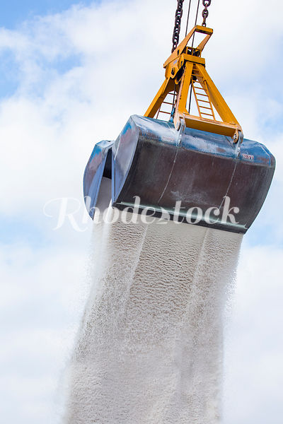 A Crane Drops a Pile of Road Salt