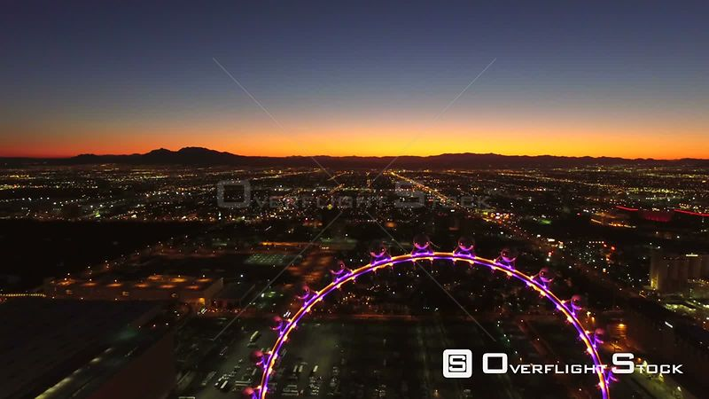 Low flying backwards aerial over high roller ferris wheel and strip Las Vegas Nevada